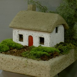 White Irish Cottage House Garden Art